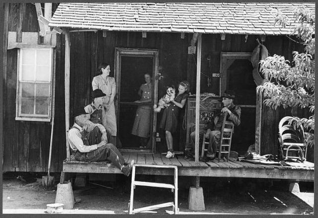 Sharecroppers on porch, Missouri 1938